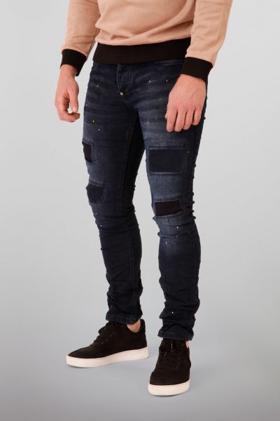 Denim Jeans Met Patches En Verfspetters